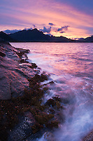 Rugged rocky coastline and mountain view at Stamsund, Vestvågøy, Lofoten islands, Norway