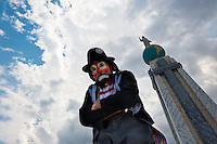 A clown from Costa Rica, a participant of the Clown Congress, poses for a picture on Plaza Salvador del Mundo in San Salvador, El Salvador, 18 May 2011. The clown performance is considered a regular job in most of Latin American countries. Clowns may work individually or in groups, often performing advertisement like acts in large open-to-street shops or they take part in private shows, like children birthdays, family events etc. There are many clown conventions all over Latin America where clowns gather and exchange their experiences offering workshops of the comic acting or the art of make-up. For some of them, being clown is a serious lifetime profession.