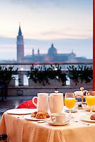 Breakfast at 'Terrazza Danieli' of the Hotel Danieli, with a magical view to the Basilica of San Giorgio Maggiore, Venice, Italy
