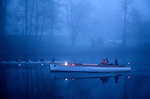 Sunrise on the Montlake Cut crew rowing on calm waters with coaches following