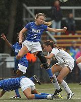 Duke University midfielder Kaitlyn Kerr (5) tracks a corner kick for a header.Boston College (white) defeated Duke University (blue/white), 4-1, at Newton Campus Field, on October 6, 2013.