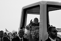 Pope Benedict XVI arrives in the papamobile to the altar to serve the open-air mass in Stara Boleslav, one of the main pilgrimage site of the Czech Republic, September 28, 2009.