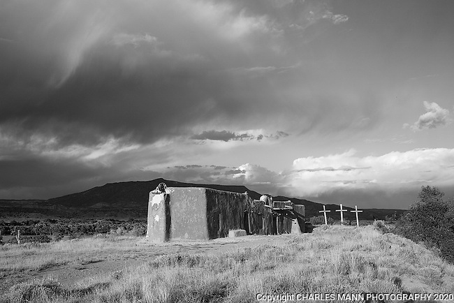 A morada, or Penitente chapel, sits on a hill about the village of Abiquiu, New Mexico.