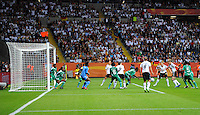 Simone Laudehr (3rd right) of team Germany scores the opening goal against Nigeria during the FIFA Women's World Cup at the FIFA Stadium in Frankfurt, Germany on June 30th, 2011.