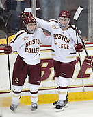 Austin Cangelosi (BC - 26) and Ryan Fitzgerald (BC - 19) celebrate Cangelosi's goal which made it 3-1 BC. - The Boston College Eagles defeated the visiting University of New Hampshire Wildcats 6-2 on Friday, December 6, 2013, at Kelley Rink in Conte Forum in Chestnut Hill, Massachusetts.