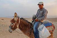 Uda a bedouin man from the tribe of Jahalin makes his way bake to the rest area at the end of the day.  Photo by Oren Nahshon