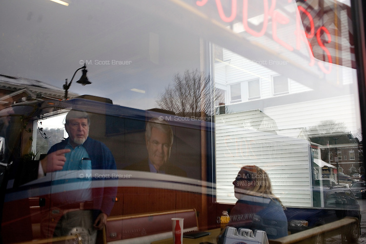 Former Speaker of the House Newt Gingrich's campaign bus drives through downtown Littleton, New Hampshire.  Gingrich is seeking the 2012 Republican nomination for president.