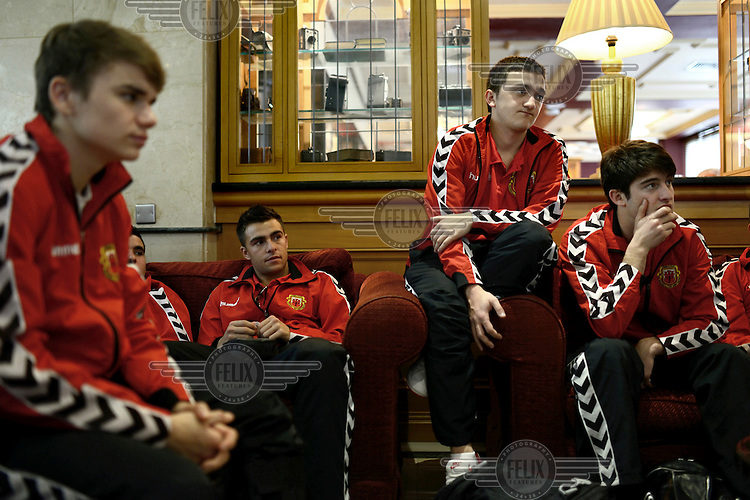 Players from the Gibraltarian under-17 national team  listen to their coach at their hotel prior to a match against Northern Ireland played in March 2013. Although the United Nations doesn't recognise Gibraltar as an independent country, UEFA has recognised it and has granted the British Overseas Territory full UEFA membership.