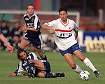 Michael Mols with his trademark turn around Dundee's Marco Di Marchi
