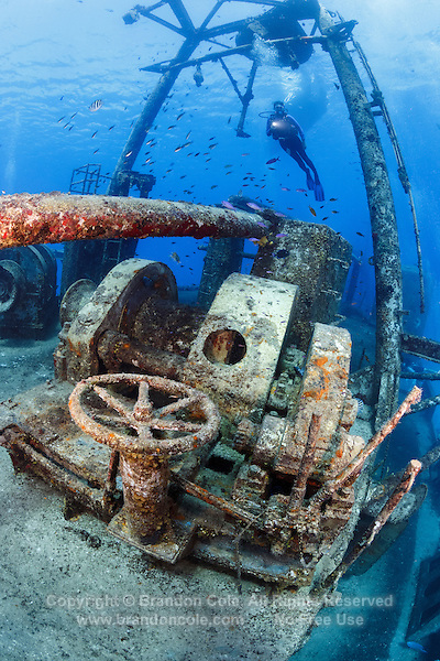 TR4589-D. scuba diver (model released) swims above deck machinery on the USS Kittiwake sunken ship, which was a diver support vessel in the US Navy. Sunk deliberately in 2011 to make an artificial reef. Now one of the most popular dive sites on Grand Cayman Island. Cayman Islands, Caribbean Sea.<br /> Photo Copyright &copy; Brandon Cole. All rights reserved worldwide.  www.brandoncole.com