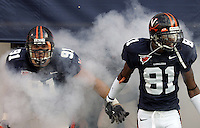 Left, UVa's Chris Long and Deyon Williams enter onto the field before the 51-3 win over Temple Saturday at Scott Stadium. Photo/Andrew Shurtleff..football