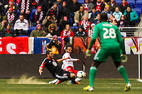 Thierry Henry (14) of the New York Red Bulls crosses the ball. The New York Red Bulls and D. C. United played to a 0-0 tie during a Major League Soccer (MLS) match at Red Bull Arena in Harrison, NJ, on March 16, 2013.