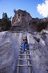 woman on ladder at Bandelier National Monument, Alcove House
