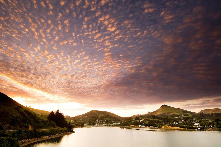 Sunrise over Harbour Cone and Portobello village on the Otago Peninsula near Dunedin