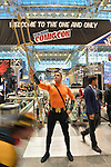 Manhattan, New York City, New York, USA. October 10, 2015. ANGEL MARTINEZ, from Maryland, is a cosplayer portraying Aquaman, holding his gold trident in front of the Welcome To The One And Only New York Comic Con banner at the 10th Annual NYCC. NYCC 2015 is expected to be the biggest one ever, with over 160,000 attending during the 4 day ReedPOP event, from October 8 through Oct 11, at Javits Center in Manhattan