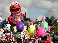 Elmo and his goldfish Dorothy are preceded by a school of colorful fish and a killer whale during the Big Bay Balloon Parade along Harbor Drive. (Photo by Fred Greaves)