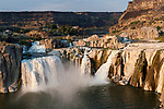 The Snake River flows over Shoshone Falls in Idaho five miles east of Twin Falls. Shoshone Falls is often referred to as the &quot;Niagara of the West&quot; due to its height of 212 feet, which is 36 feet higher than Niagara Falls and its 900 foot wide rim. Summer irragation and dams upstream limit the waters flow in the summertime. Photographed 08/06