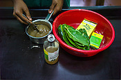Workers prepare the leaf treatment at the National Research Institute of Panchakarma in Cheruthuruthy in Thissur district of Kerala, India.