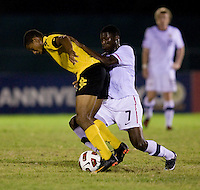 Alfred Koroma (7) of the United States fights for the ball with Omar Holness (9) of Jamaica during the semifinals of the CONCACAF Men's Under 17 Championship at Catherine Hall Stadium in Montego Bay, Jamaica. The United States defeated Jamaica, 2-0.
