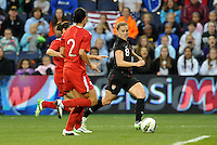 USWNT midfielder Amy Rodriguez (8) runs down the wing.....USWNT played to a 1-1 tie with Canada at LIVESTRONG Sporting Park, Kansas City, Kansas.