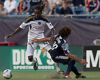 Philadelphia Union midfielder Keon Daniel (17) makes hard cut as New England Revolution defender Kevin Alston (30) defends. In a Major League Soccer (MLS) match, the Philadelphia Union defeated the New England Revolution, 3-0, at Gillette Stadium on July 17, 2011.
