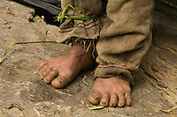 Bolo Kesher harvest without shoes.