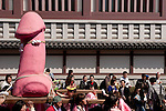 Transvestites from the Elizabeth Club carry a large pink phallus on a mikoshi or portable shrine during the Kanamara matsuri or festival of the iron phallus  in Kawasaki Daishi, Kanagawa, Japan April 6th 2008