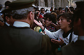 "Santiago, Chile.September 27, 1988..An anti-General Augusto Pinochet rally takes place near a prison prior to the plebiscite vote. Police confront the demonstrators...In 1988, General Augusto Pinochet ordered a plebiscite vote asking Chilean citizens whether he should continue in office. It produced a decisive ""no"" vote and the following year he lost the first presidential election in 19 years. However, under a constitution crafted by his advisors, he remained as army commander until 1998. Pinochet continued to wield enormous power until his arrest in London on human rights charges in October 1998."