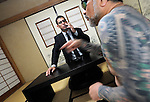 """JJake Adelstein, a former reporter at Japan's largest daily newspaper, Yomiuri Shimbun, and author of """"Tokyo Vice"""", speaks with his bodyguard, a former yakuza mobster who goes by the name """"Mochizuki,"""" at an undisclosed location in Japan on Aug. 29, 2008. In 2005 American Adelstein uncovered a scandal involving senior members of Japan's mafia, the yakuza, visiting a medical center in Los Angeles to undergo liver transplants, despite being bared from entry due to having criminal records or suspected affiliation with Japanese organized crime groups. Within days, however, Adelstein was visited by mob members and told to either """"erase the story or be erased."""" He took the former option and resigned from the Yomiuri, though a leak of his story at the time of this interview pushed Adelstein and his family into hiding..Photographer: Robert Gilhooly"""