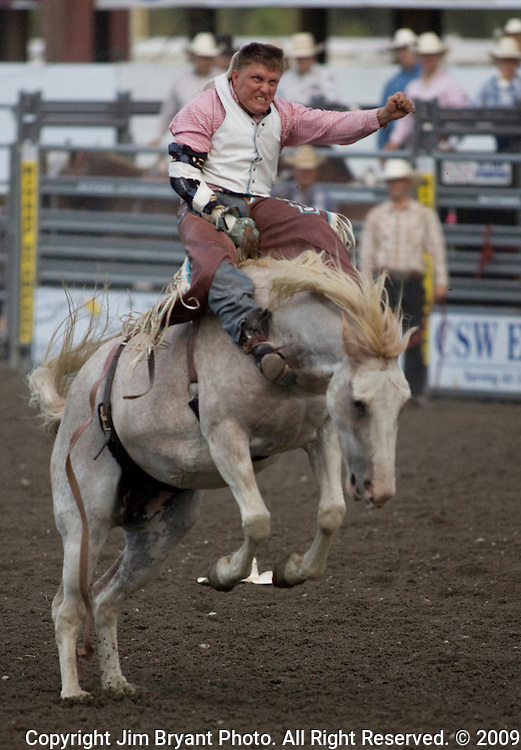 Heath Ford, from Greeley, CO., hangs on during the Bareback Riding  Competition at the Kitsap County Fair and Stampede  held Aug. 26 to Aug. 30, 2009 in Silverdale, WA.  Jim Bryant Photo. All Right Reserved. © 2009
