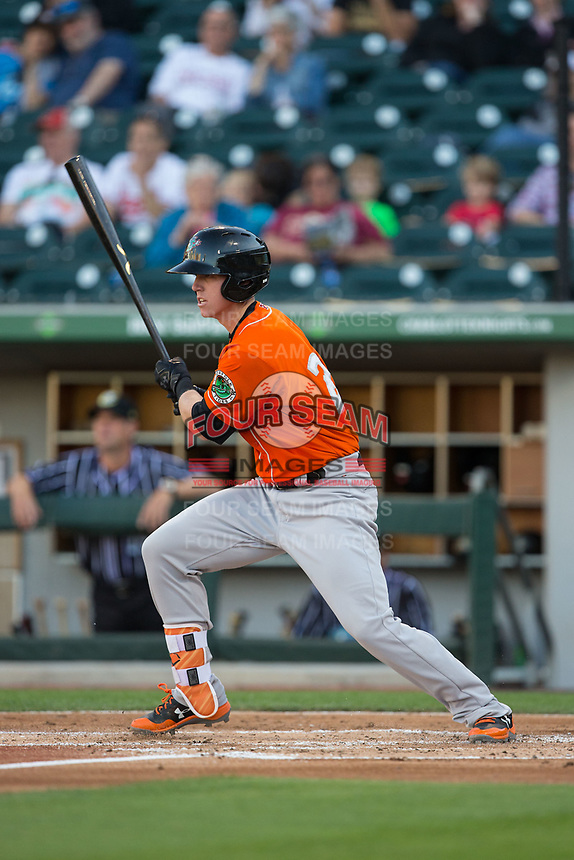 Chance Sisco (23) of the Norfolk Tides follows through on his swing against the Charlotte Knights at BB&T BallPark on May 2, 2017 in Charlotte, North Carolina.  The Knights defeated the Tides 8-3.  (Brian Westerholt/Four Seam Images)