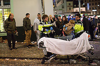 Paramedics lift a woman out of a shopping cart onto an ambulance bed during the second night of festivities for Fasnacht, the Carnival of Basel, in Switzerland. Feb. 24, 2015.