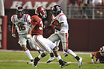 Ole Miss wide receiver Jesse Grandy (10) is tackled by Alabama defensive back Robert Lester (37) at Bryant-Denny Stadium in Tuscaloosa, Ala.  on Saturday, October 16, 2010. Alabama won 23-10.