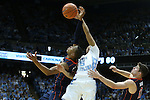 16 February 2013: North Carolina's Marcus Paige (5) wins a rebound from Virginia's Akil Mitchell (left) and Joe Harris (12). The University of North Carolina Tar Heels played the University of Virginia Cavaliers at the Dean E. Smith Center in Chapel Hill, North Carolina in a 2012-2013 NCAA Division I and Atlantic Coast Conference men's college basketball game. UNC won the game 93-81.