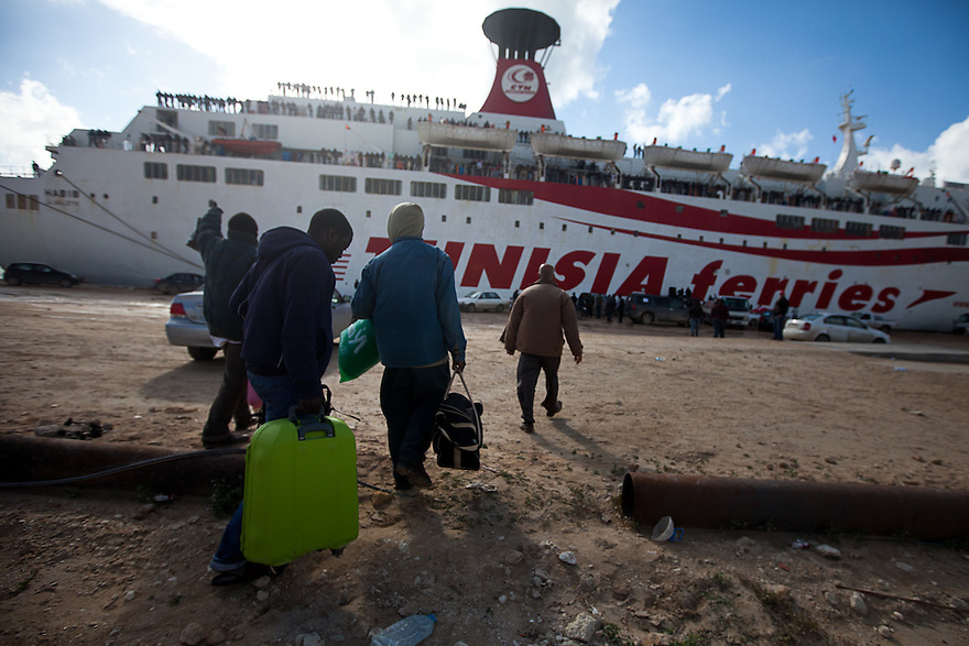 Workers from Ghana try to board a Tunisian vessel which is only taking Tunisians and Morrocans  in Benghazi on Feb. 26, 2011, many people from poorer countries are stranded in Libya.