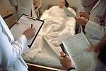 doctors examining patient in hospital