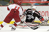 Kyle Criscuolo (Harvard - 11) scores his first collegiate goal against Marco De Filippo (Brown - 31). - The Harvard University Crimson defeated the visiting Brown University Bears 3-2 on Friday, November 2, 2012, at the Bright Hockey Center in Boston, Massachusetts.
