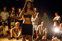 Visitors watching young beautiful Tahitian woman dancing