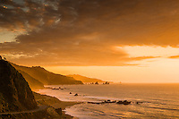 Intense sunset over rugged coastline with State Highway 6 near Punakaiki, Buller Region, West Coast, New Zealand