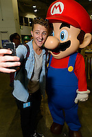 A selfie with Mario, Hyper Japan 2014, Earls Court, London, UK, July 25, 2014. Hyper Japan is the UK's largest Japanese culture event. It took place at the Earls Court exhibition space from 25 to 27 July 2014.