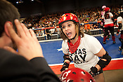 Crybaby of the Putas del Fuego, a TXRD team in Austin, Texas, discusses a game plan with team manager Senor Miguel Hunt during their bout against the Hellcats at Palmer Events Center in Austin, Texas.