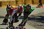 Skateboarders at the first Whistler Longboard Festival race down a one-mile track that drops 1000 feet and contains eight 180º degree hairpin turns. The paved road, used as a track, is the access road to the Whistler Sliding Center, built for the 2010 Winter Olympics in Whistler.  June 26, 2011.   Photo by Gus Curtis