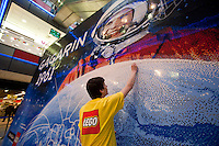 Employee adjusts parts of the world record breaker mosaic image of Russian astronaut Yuri Gagarin in Budapest, Hungary on March 27, 2011.<br /> The 30 square meters large mosaic image is made up from 470 016 Lego pieces and was built to celebrate the 50th anniversary of the first space flight. The national record is alredy validated and the international Guinness Record validation is in progress. ATTILA VOLGYI