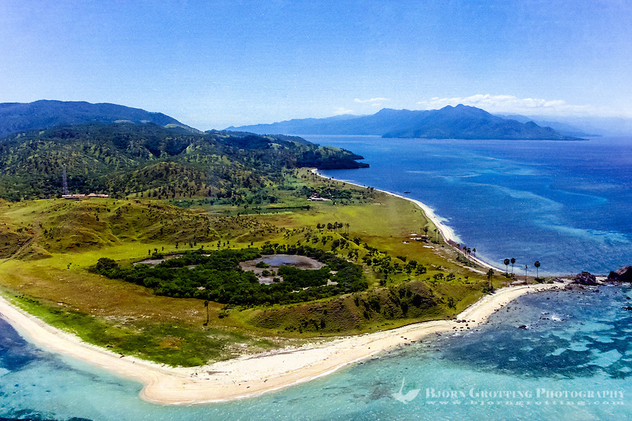 Maluku, South East Maluku, Pulau Liran. The south west tip of Liran. Looking north east with Wetar in the background. There is only a small village and a lighthouse here (from helicopter).