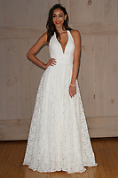 Model poses in a Galina bridal gown for the David's Bridal Fall 2017 fashion show presentation on April 19, 2017; during New York Bridal Fashion Week.
