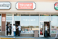 The Rhode Island state campaign headquarters for Republican presidential candidate Donald Trump are located between a hockey equipment store and a pizzeria in the Airport Plaza strip mall in Warwick, Rhode Island, USA, on Sun., Apr. 24, 2016. The campaigns of Trump, Cruz, and Kasich, have all set up offices in the strip mall.