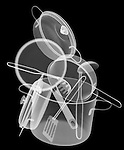 X-ray image of a pot and pan stack (white on black) by Jim Wehtje, specialist in x-ray art and design images.