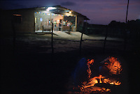 Ranch workers light a bonfire outside the dance pavillion on the Fazenda Bonfim ranch near São José de Mipibu, Brazil, Saturday, Jan. 14, 2006. Rancher Marcos Fernandez Lopes holds the Forró da Lua, or Forró of the moon, under a full moon each month. (Kevin Moloney for the New York Times)