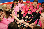 The Hellcats bond after their loss to Putas del Fuego at the Palmer Events Center in Austin, Texas.