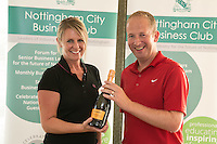 Nearest the 2nd pin sponsor Jenna Frudd hands the prize to Simon Browning